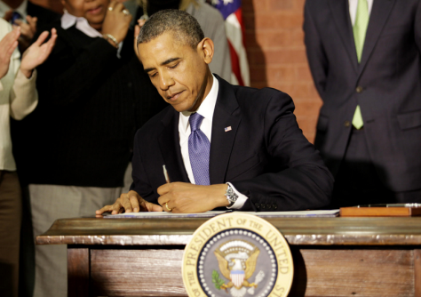 President Barack Obama signs the Omnibus Spending Bill in Washington