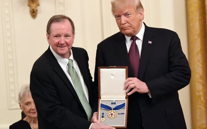 Jack Soden, CEO of Elvis Presley Enterprises, accepts the Presidential medal of Freedom award